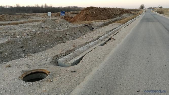 Незавершенные работы на дороге 49К-2122 в районе деревни Новое Овсино.